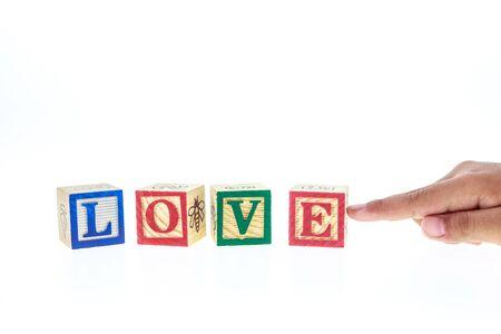 alphabet blocks: LOVE written in colorful alphabet blocks isolated on white background