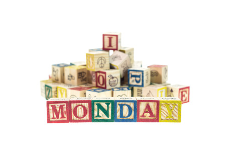 studio b: Monday written in letter colorful alphabet blocks isolated on white background Stock Photo