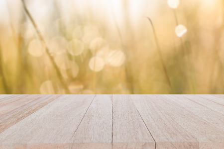 Close up top wooden table on blur and bokeh background Stock Photo