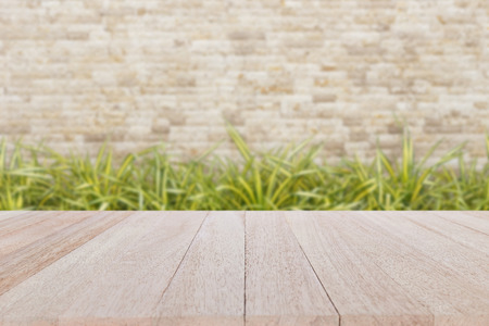 Close up top wooden table and blur of natural stone background Stockfoto