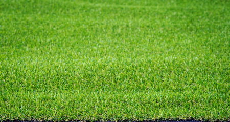Pattern of green artificial grass for texture and background Stock Photo