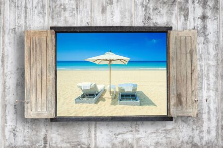 blue sky background: Old wooden windows frame on cement wall and view of tropical sea