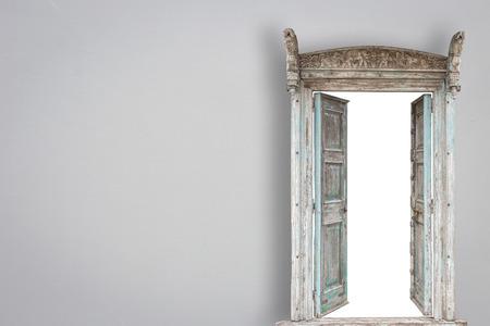 Grey retro style wooden door on gery cement wall background Standard-Bild