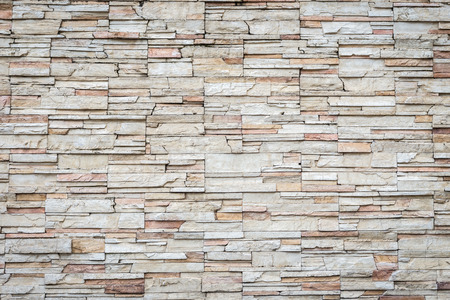 brick facades: Close up Pattern of travertine natural stone wall texture and background Stock Photo