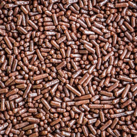 chocolate sprinkles: Macro pattern of chocolate sprinkles texture and background