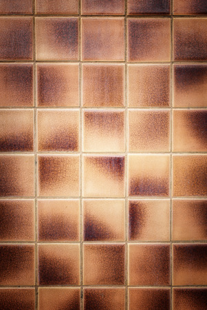 wall tile: Close up old pattern brown ceramic bathroom wall tile texture and background