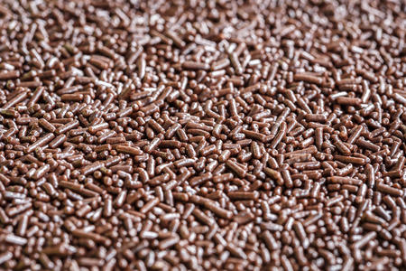 chocolate sprinkles: Macro pattern of chocolate sprinkles texture and background