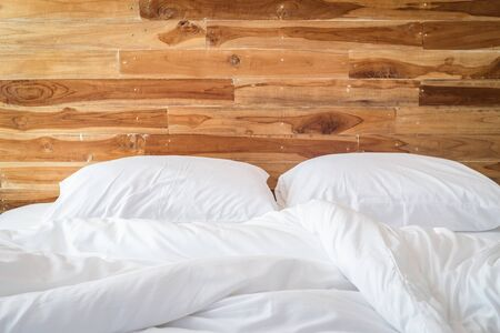 Close up white bedding sheets and pillow, Messy bed concept Foto de archivo