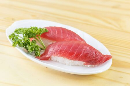 maguro: Traditional japanese food, Maguro (Tuna) sushi on wooden table Stock Photo