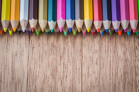 pencil drawings: Close up stack colour pencils on wooden background Stock Photo
