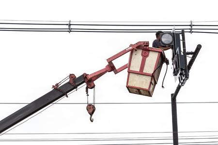 light worker: Thai worker on crane for install traffic light isolated on white background Stock Photo