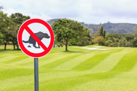 pooping: Round no dog pooping sign golf course Stock Photo