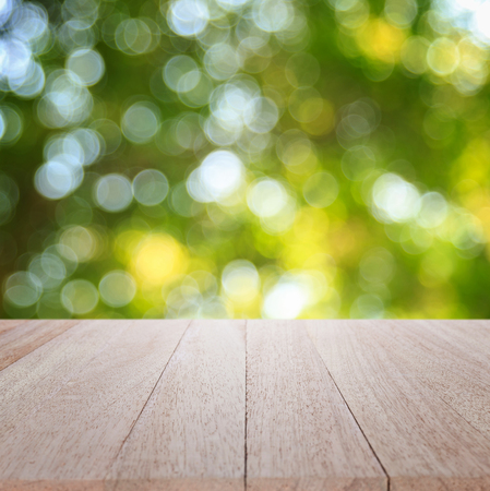 spring green: Empty top wooden table and sunny abstract blurred bokeh background