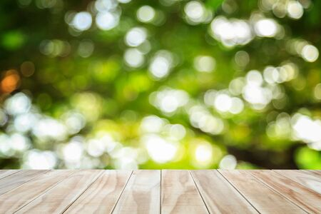 sunny: Empty top wooden table and sunny abstract blurred bokeh background