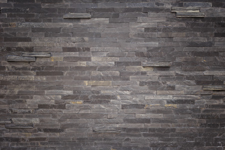 black stones: Pattern of black slate wall texture and background Stock Photo