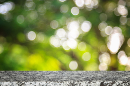 Empty top of natural stone table and sunny abstract blurred bokeh background Stock Photo