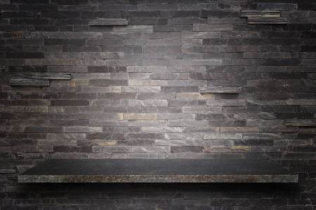 stone wall: Empty top of natural stone shelves and stone wall background. For product display