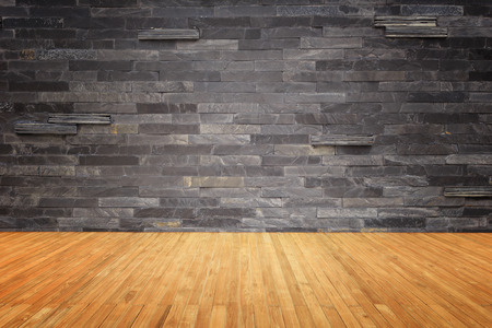 black stones: Empty top of wooden floor and natural stone wall background