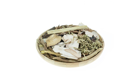 codonopsis roots: Mix of chinese herbal medicine in wooden dish isolated on white background Stock Photo
