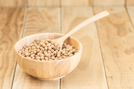 soja: Close up soy beans in bowl on wooden desk