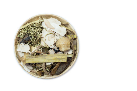 healing plant: Mix of chinese herbal medicine in wooden dish isolated on white background Stock Photo
