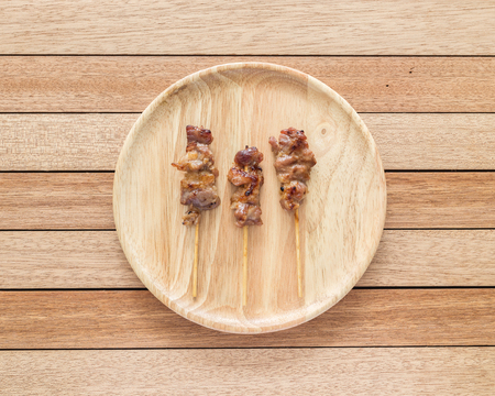 bamboo stick: Top view grilled pork with bamboo stick on wooden dish
