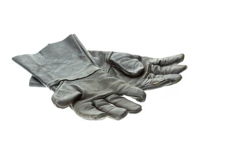 work glove: Old black work glove isolated on white background Stock Photo