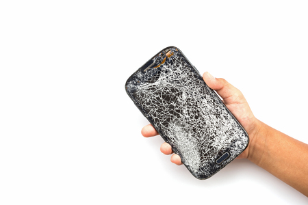 broken telephone: Hand holding broken smart phone isolated on white background