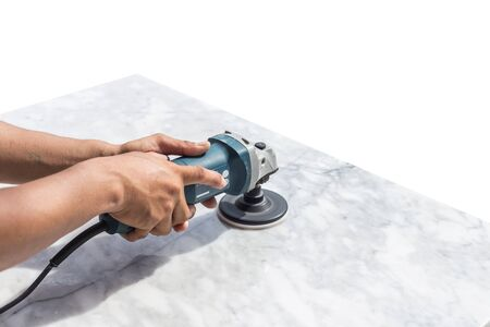 Man polishing marble stone table by small angle grinder Stock Photo