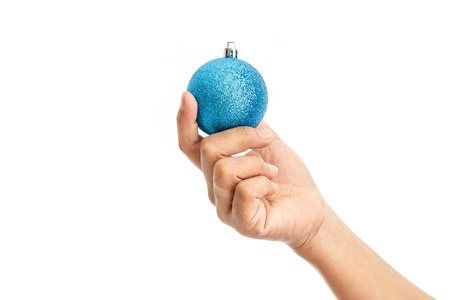 ball isolated: Close up hand holding Christmas ball isolated on white background