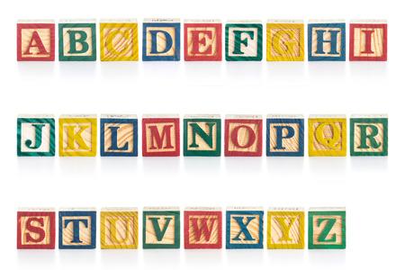 Colorful wood alphabet blocks isolated on white background