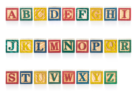 Colorful wood alphabet blocks isolated on white background