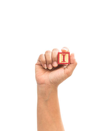alphabet blocks: Hand holding colorful alphabet blocks I isolated on white background Stock Photo