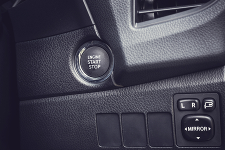 glass button: Detail of new modern car interior, Focus engine start button