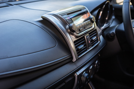 shiny car: Detail of new modern car interior, Focus on stereo Stock Photo