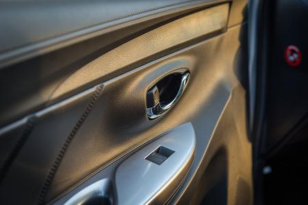 Detail Of New Modern Car Interior Focus On Door Handle Stock Photo