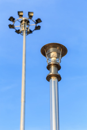 lamp on the pole: Stainless steel lamp pole at the road on blue sky background