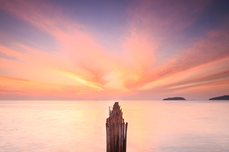 kata: Bamboo wall in the sea and beautiful sunrise at Saphan Hin, Phuket, Thailand