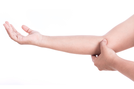 codo: Close up womans hand holding her elbow isolated on white background. Elbow pain concept.