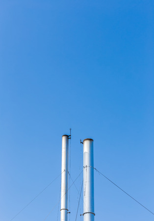 smokestacks: Two smokestacks on blue sky background in Phuket, Thailand
