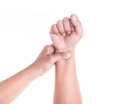 elbow pain: Close up womans hand holding her wrist isolated on white background. Elbow pain concept.