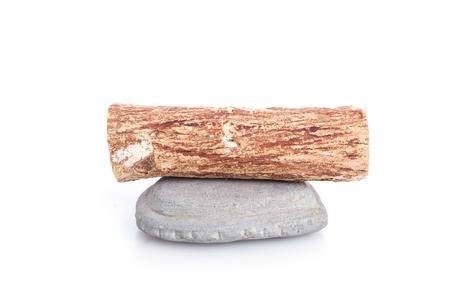 face in tree bark: Thanaka wood and grey Kyauk Pyin stone slabs isolated on white background