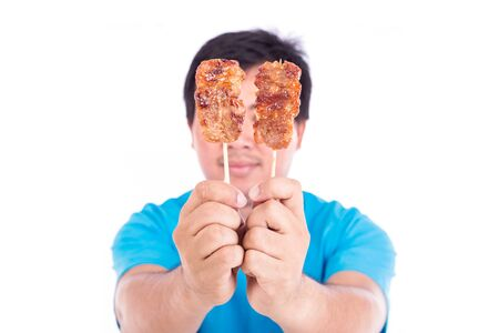 bamboo stick: Man holding grilled pork in bamboo stick isolate on white background