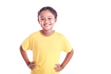 arms akimbo: Portrait of young Asian girl with arms akimbo isolated on white background Stock Photo