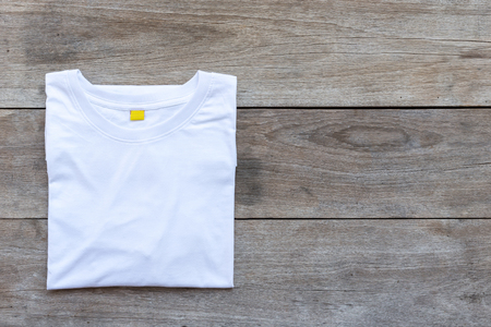 Top view of color T-Shirt on grey wood plank background Banco de Imagens