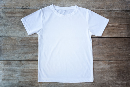 fold: Top view of color T-Shirt on grey wood plank background Stock Photo