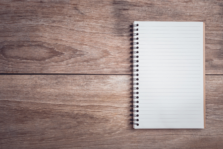 Close up notepad  lined paper on wooden table top view