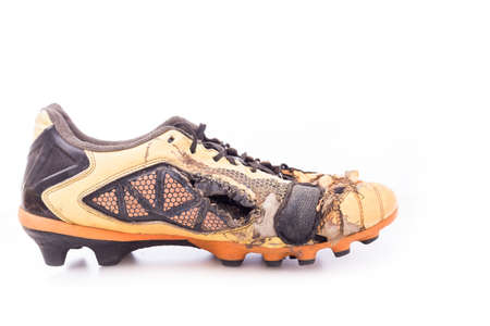 football shoes: Old football shoes isolated on white background Stock Photo