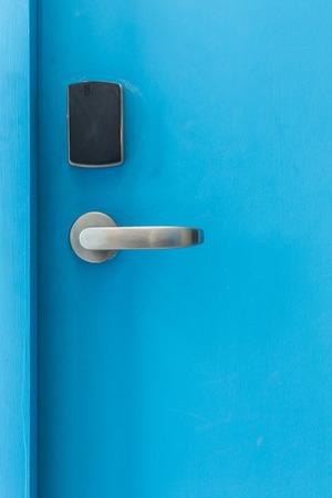 keycard: Blue entrance door with electronic keycard lock system