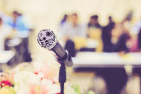 lectern: Close up microphone on the desk in meeting room with blur people background, With vintage filter effect